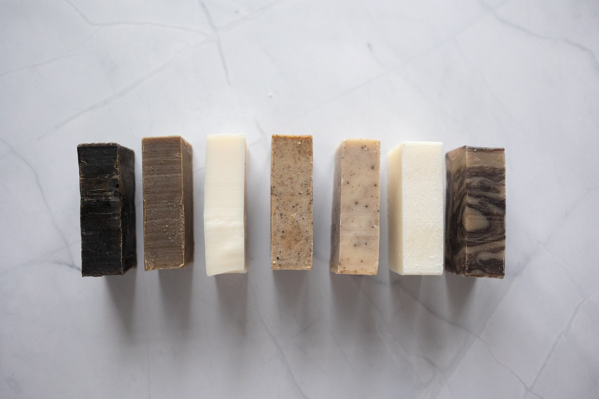 7 bars of homemade soap in natural shades of white and brown