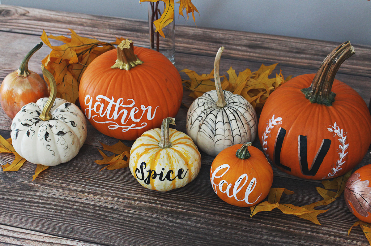 A display of hand painted pumpkins creating an autumn display